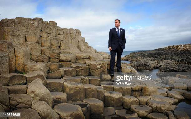 Prime Minister David Cameron stands on the Giant's Causeway where he viewed the new visitor's centre on August 01, 2012 in County Antrim, Northern...