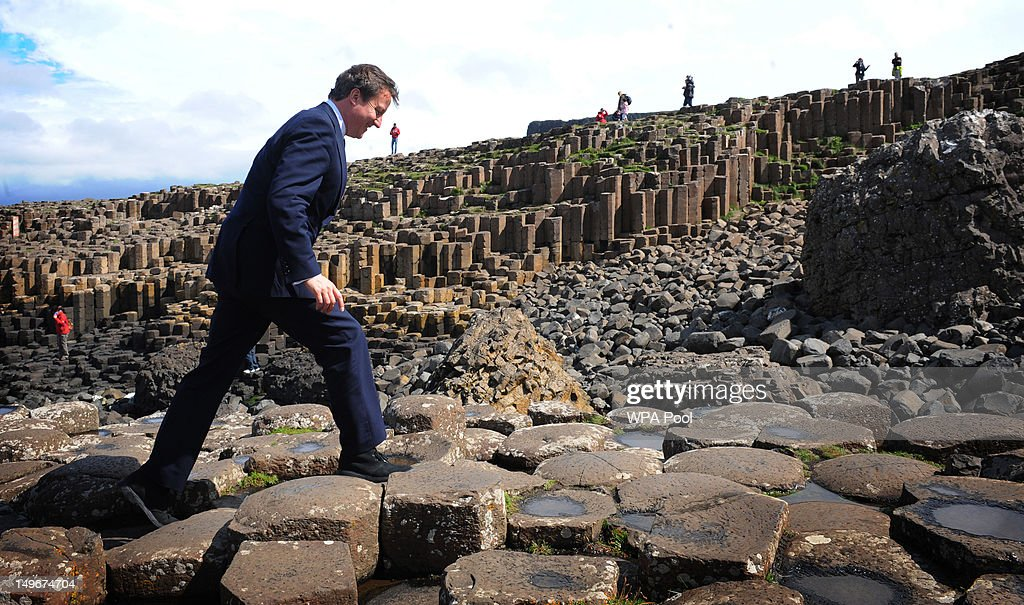 Prime Minister David Cameron stands on the Giant's Causeway where he viewed the new visitor's centre on August 01, 2012 in County Antrim, Northern Irland. The new vistors centre, part financed by the European Regional Development Fund, the Northern Ireland Tourist Board (NITB), the Heritage Lottery Fund, and the National Trust, and has welcomed over 85,000 people in its first four weeks.