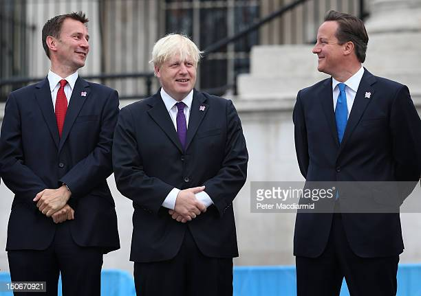 Prime Minister David Cameron stands with London Mayor Boris Johnson and Culture Secretary Jeremy Hunt as the Olympic cauldron is lit for the...