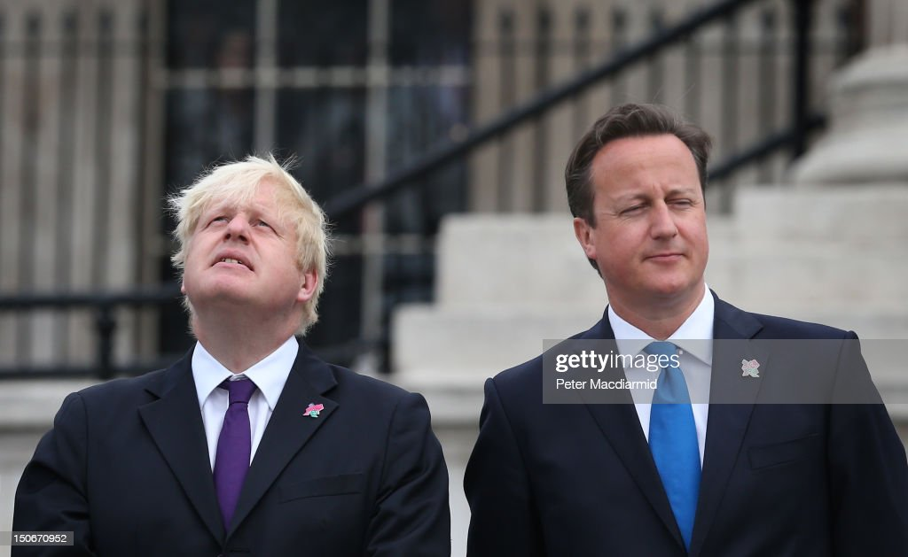 Prime Minister David Cameron (R) stands with London Mayor Boris Johnson as the Olympic cauldron is lit for the Paralympic Games in Trafalgar Square on August 24, 2012 in London, England. The London 2012 Paralympic Games open on August 29, 2012 for 12 days.