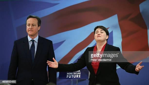 Prime Minister David Cameron stands with the leader of Scottish Conservatives Ruth Davidson as they launch their election manifesto on April 16 2015...