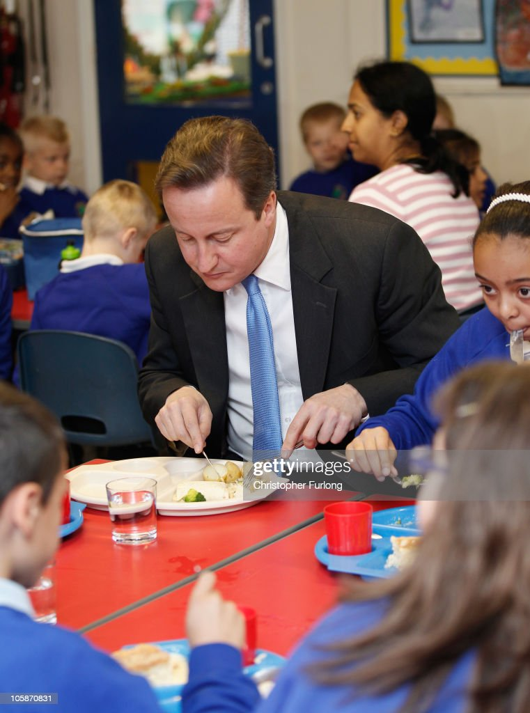 Prime Minister David Cameron takes lunch with pupils during a visit to Welbeck Primary School on October 21, 2010 in Nottingham, England. After yesterdays government spending review Chancellor George Osborne has insisted that cuts are 'fair'amidst claims that the poorest will be hit hardest.