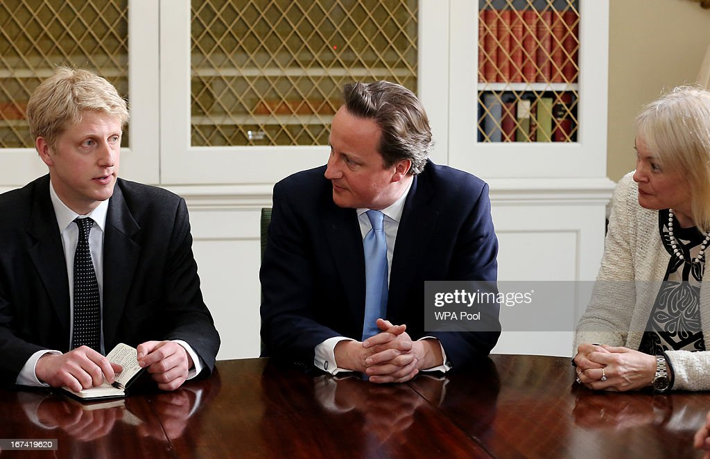 Prime Minister David Cameron (right) talks to Jo Johnson, his new head of policy, during a meeting at 10 Downing Street on April 25, 2013 in London, England. The Prime Minister has appointed Jo Johnson the younger brother of the Mayor of London, Boris Johnson to be his new Head of Policy.
