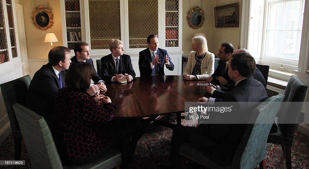 Prime Minister David Cameron talks to members of his new advisory board on policy (left to right) Jane Ellison, Jesse Norman, Jake Berry, Jo Johnson, Margot James, Paul Uppal, Nick Gibb and George Eustice during a meeting at 10 Downing Street on April 25, 2013 in London, England. The Prime Minister has appointed Jo Johnson the younger brother of the Mayor of London, Boris Johnson to be his new Head of Policy.
