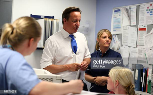 Prime Minister David Cameron talks to staff during a visit to the Salford Royal Hospital accident and emergency department on August 8 2013 in...