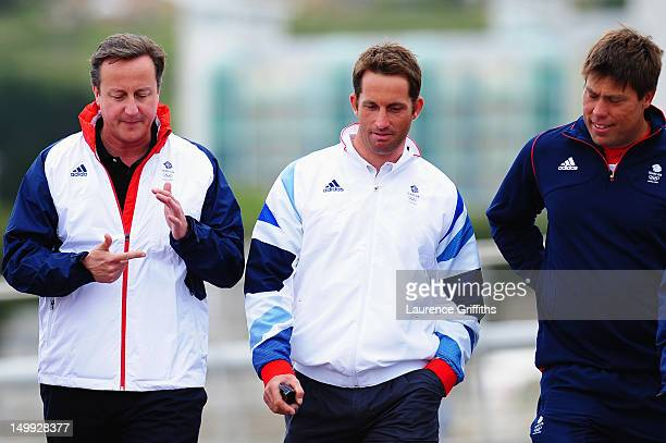 Prime Minister David Cameron talks with Finn class gold medallist Ben Ainslie and Star class silver medallist Andrew Simpson in the competition boat...