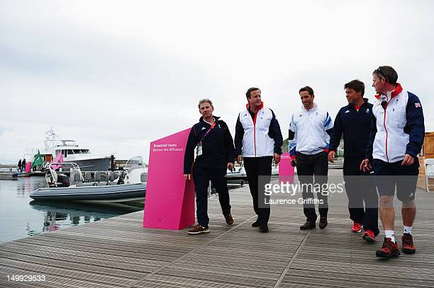 Prime Minister David Cameron talks with Finn class gold medallist Ben Ainslie and Star class silver medallist Andrew Simpson and John Derbyshire and...