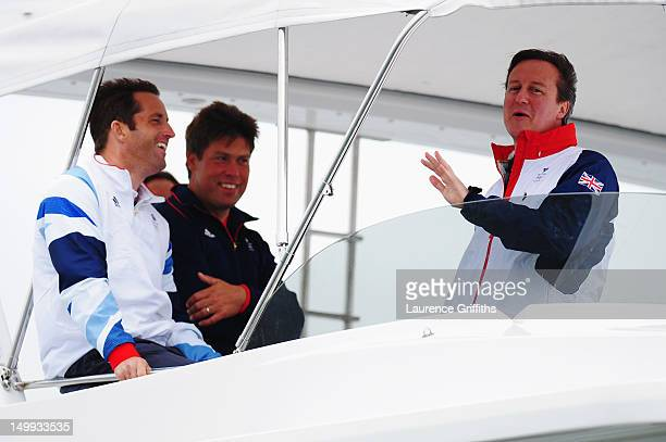 Prime Minister David Cameron talks with Finn class gold medallist Ben Ainslie and Star class silver medallist Andrew Simpson on the VIP viewing boat...
