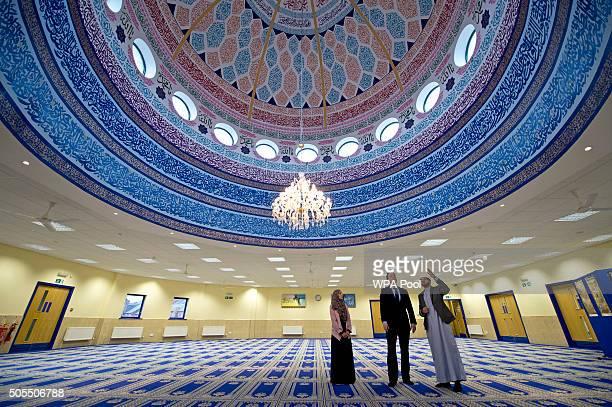 Prime Minister David Cameron talks with Imam Qari Asim and Shabana Muneer a member of Makkah Masjid mosque's women's group as he visits Makkah Masjid...