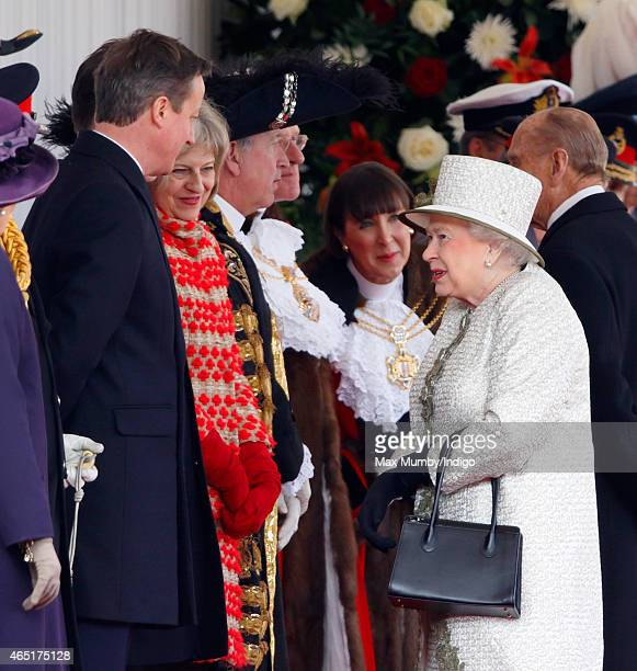 Prime Minister David Cameron talks with Queen Elizabeth II as they attend the Ceremonial Welcome for Mexican President Enrique Pena Nieto at Horse...