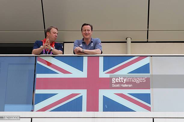 Prime Minister David Cameron talks with Team GB Chef de Mission Andy Hunt during a visit to the Olympic Village on Day 14 of the London 2012 Olympic...