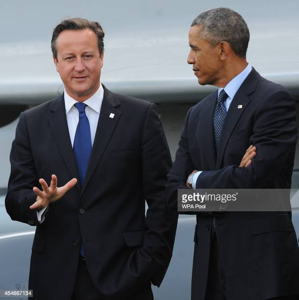 Prime Minister David Cameron US Prsident Barack Obama and other Nato leaders gather to watch a flypast of military aircraft from Nato member...