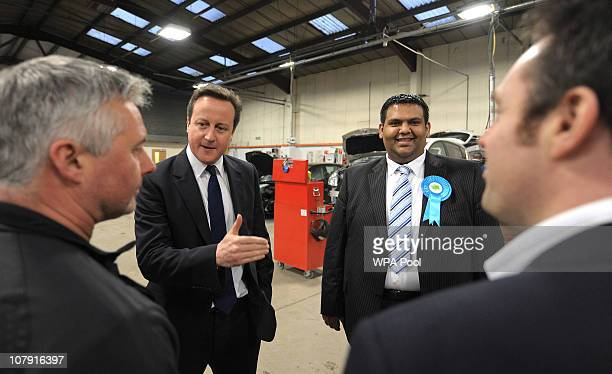 Prime Minister David Cameron visits the Adamsons Vehicle Care Centre as he campaigns with local Conservative candidate Kashif Ali on January 6 2011...