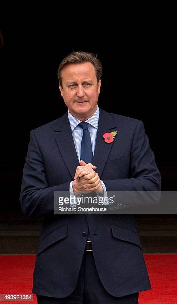 Prime Minister David Cameron waits for President Xi Jinping to arrive for lunch at Manchester Town Hall on October 23 2015 in Manchester England...