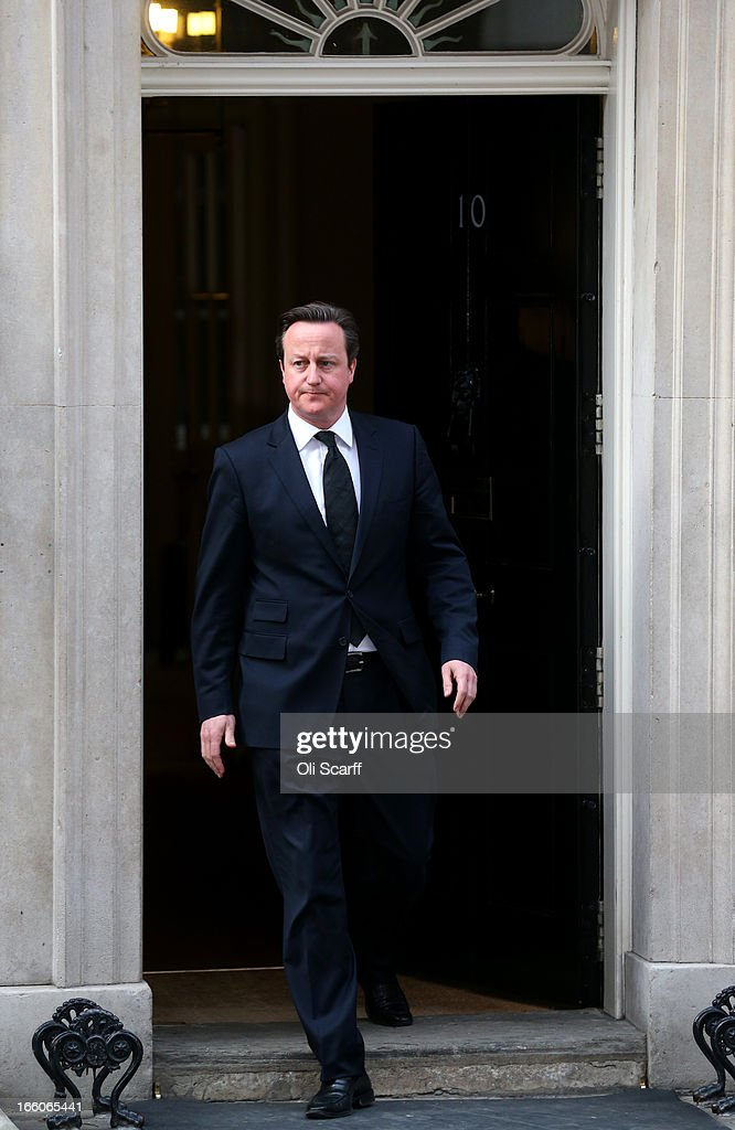 Prime Minister David Cameron walks out of the front door of 10 Downing Street to speak to the media following the death of former Prime Minister Margaret Thatcher on April 8, 2013 in London, England. Lord Bell, spokesperson for Baroness Margaret Thatcher, announced in a statement that the former British Prime Minister died peacefully following a stroke on 8th April, aged 87.