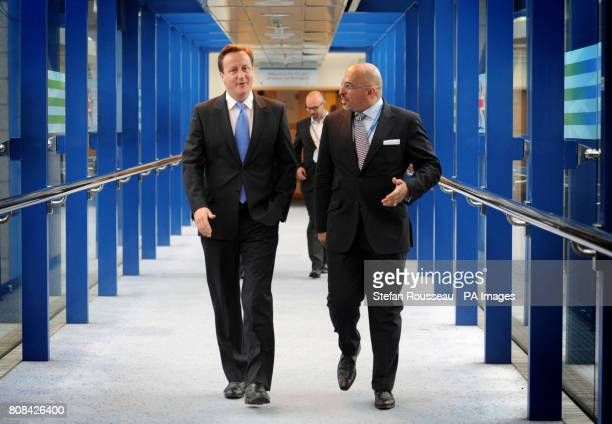Prime Minister David Cameron walks to his hotel at the Conservative Party's annual conference in Birmingham with MP Nadhim Zahawi