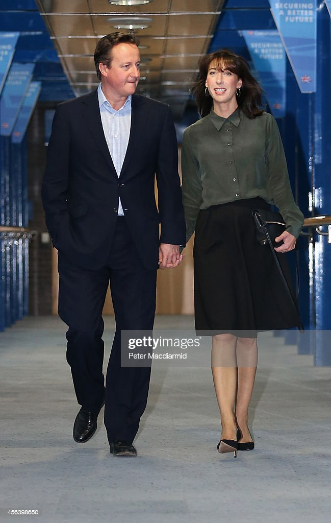 Prime Minister David Cameron walks with his wife Samantha at the Conservative party conference on September 30, 2014 in Birmingham, England. Tomorrow is the final day of conference.