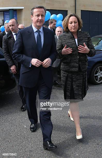 Prime Minister David Cameron walks with local parliamentary candidate AnneMarie Trevelyan as they campaign on April 13 2015 in Alnwick England As the...