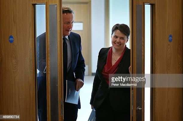 Prime Minister David Cameron walks with the leader of Scottish Conservatives as they launch their election manifesto on April 16 2015 in Glasgow...