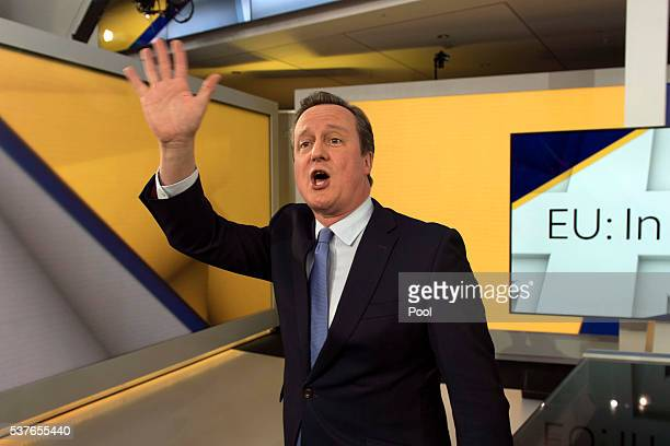Prime Minister David Cameron waves after attending a Sky News interview with Faisal Islam followed by an audience Q and A session hosted by Kay...