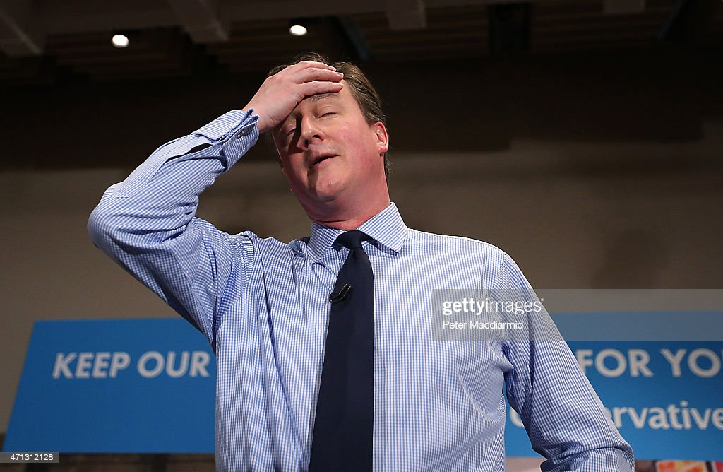 Prime Minister David Cameron wipes away some sweat as he speaks to business leaders on April 27, 2015 in London, England. Mr Cameron has started the fifth week of the general election campaign with a passionate speech in the heart of the City of London financial district.