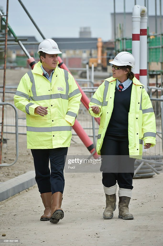 Prime Minister David Cameron with assistant site manager Gemma Goddard during a visit to the new Taylor Wimpy Great Western Park housing estate on September 27 in Didcot, Oxfordshire, England. The Prime Minister makes a visit to Didcot ahead of the start of the Conservative Party Conference.