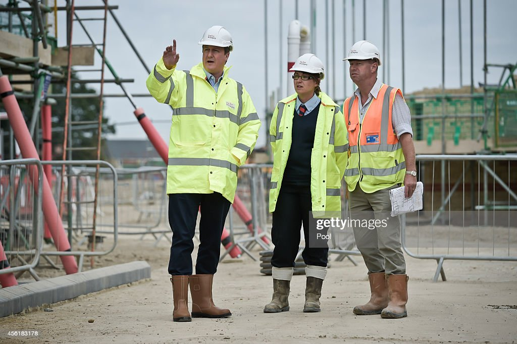 Prime Minister David Cameron with assistant site manager Gemma Goddard and senior grounds work supervisor Mick Legge during a visit to the new Taylor Wimpy Great Western Park housing estate on September 27 in Didcot, Oxfordshire, England. The Prime Minister makes a visit to Didcot ahead of the start of the Conservative Party Conference.