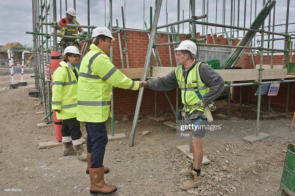 Prime Minister David Cameron with assistant site manager Gemma Goddard meet scaffolder Michael Carter during a visit to the new Taylor Wimpy Great Western Park housing estate on September 27 in Didcot, Oxfordshire, England. The Prime Minister makes a visit to Didcot ahead of the start of the Conservative Party Conference.