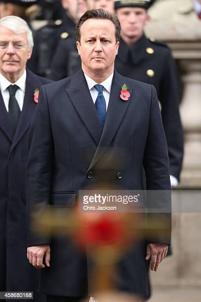 Prime Minister David Cameron with John Major attend the annual Remembrance Sunday Service at the Cenotaph on Whitehall on November 9 2014 in London...