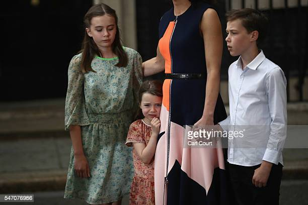 Prime Minister David Cameron's children Nancy Cameron Arthur Cameron and Florence Cameron are seen as he speaks for the last time as he leaves...