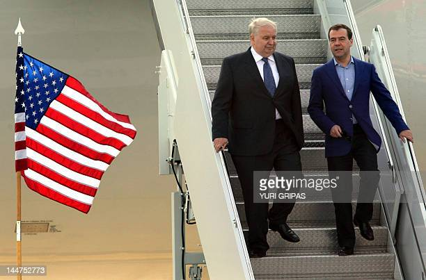Prime Minister Dmitry Medvedev confers with Russian ambassador to US Sergey Kislyak upon arrival at Washington Dulles International airport for the...