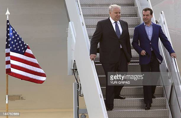 Prime Minister Dmitry Medvedev walks down with Russian ambassador to US Sergey Kislyak upon his arrival at Washington Dulles International airport...