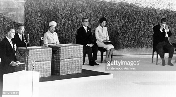 Prime Minister Eisaku Sato, far right, wipes his eyes as Vice-President Spiro Agnew reads the Presidential proclamation reverting Okinawa back to...
