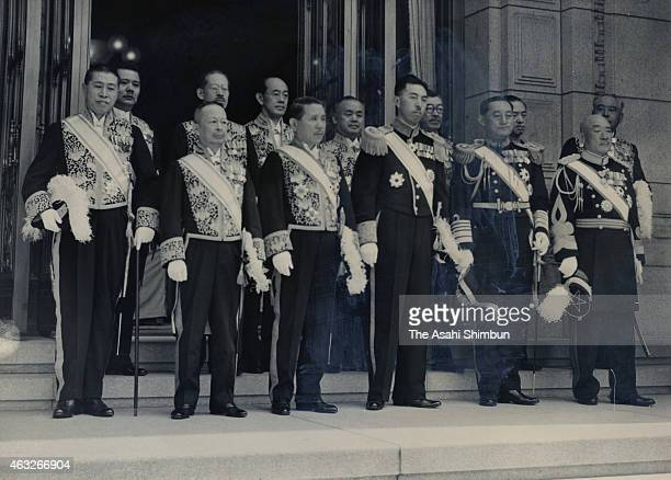 Prime Minister Fumimaro Konoe and other cabinet members pose for photographs prior to the opening of the extraordinary session of the Imperial diet...