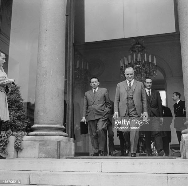 Prime Minister Georges Pompidou leaves Elysee Palace after meeting of the Council of Ministers during May 1968 crisis with Minister Edmond Michelet...