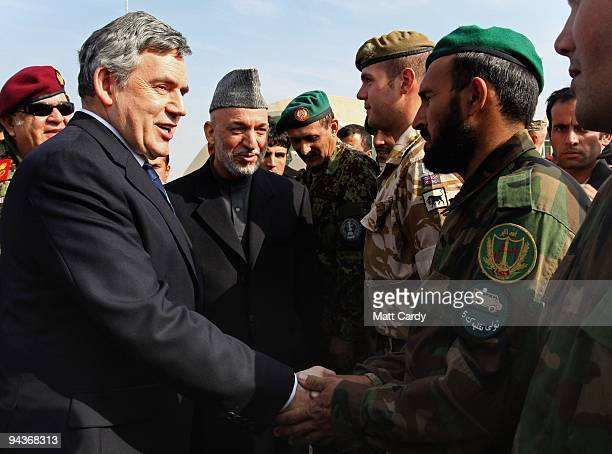 Prime Minister Gordon Brown and Afghan President Hamid Karzai meet Afghan and British troops at Kandahar Airbase on December 13 2009 in Kandahar...
