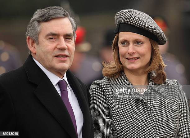 Prime Minister Gordon Brown and his wife Sarah Brown wait to meet HM Queen Elizabeth at the unveiling of a new statue of Queen Elizabeth, the Queen...