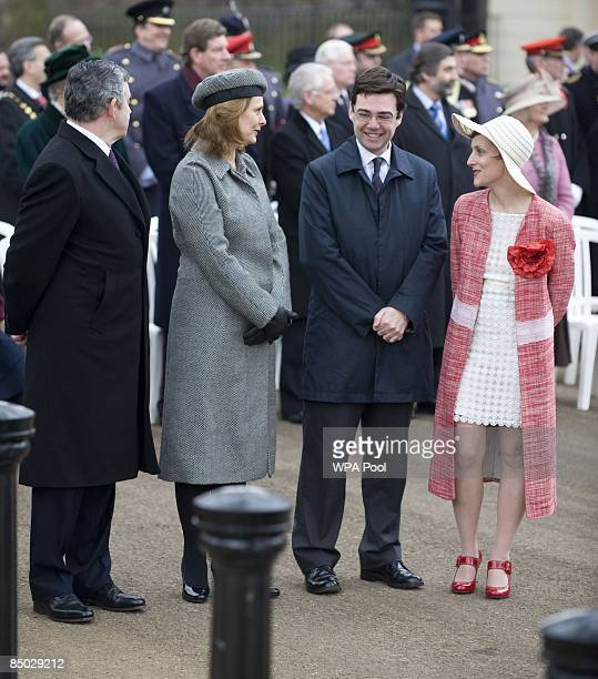 Prime Minister Gordon Brown and his wife Sarah speak to MarieFrance van Heel wife of Britain's Minister of Culture Media and Sport Andy Burnham as...