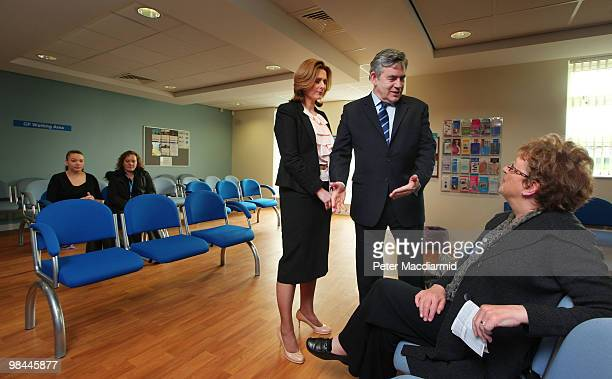 Prime Minister Gordon Brown and his wife Sarah talk to a patient as they visit a health centre on April 14 2010 in Yeadon near Leeds England The...
