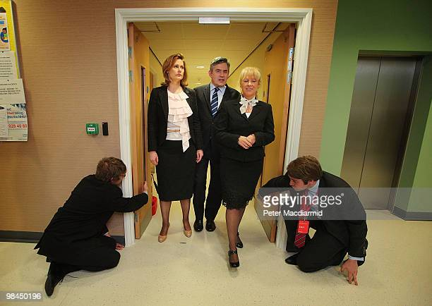 Prime Minister Gordon Brown and his wife Sarah walk with Sam Prince from the National Health Service as they visit a health centre on April 14 2010...