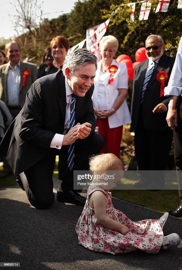 Prime Minister Gordon Brown bends down to applaud 18 month old Caitlin Atkins in the back garden of a house on April 23, 2010 in Bedworth, England. The General Election, to be held on May 6, 2010, is set to be one of the most closely fought political contests in recent times with all main party leaders embarking on a four week campaign to win the votes of the United Kingdom electorate.