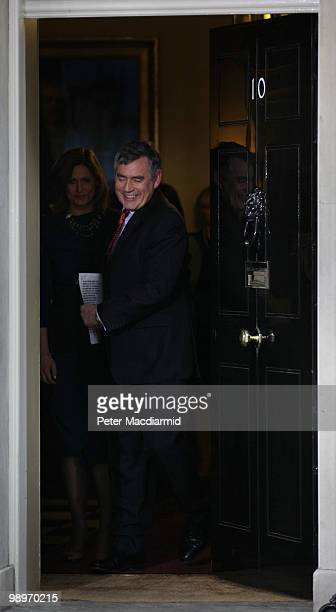 Prime Minister Gordon Brown leaves Downing Street after resigning with his wife Sarah on May 11 2010 in London England After five days of negotiation...