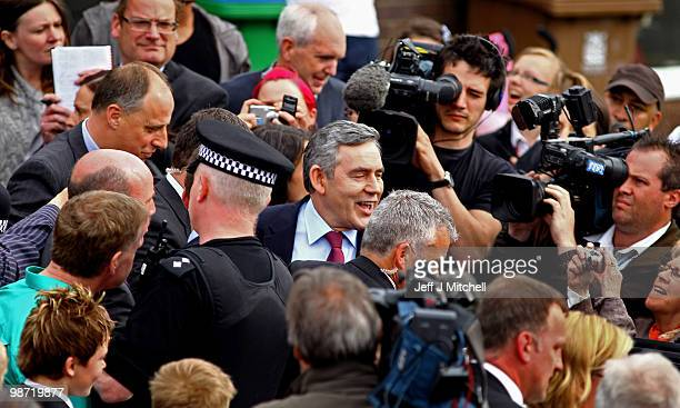 Prime Minister Gordon Brown leaves the home of pensioner Gillian Duffy after making an apology for referring to her as a 'bigoted woman' on April 28...