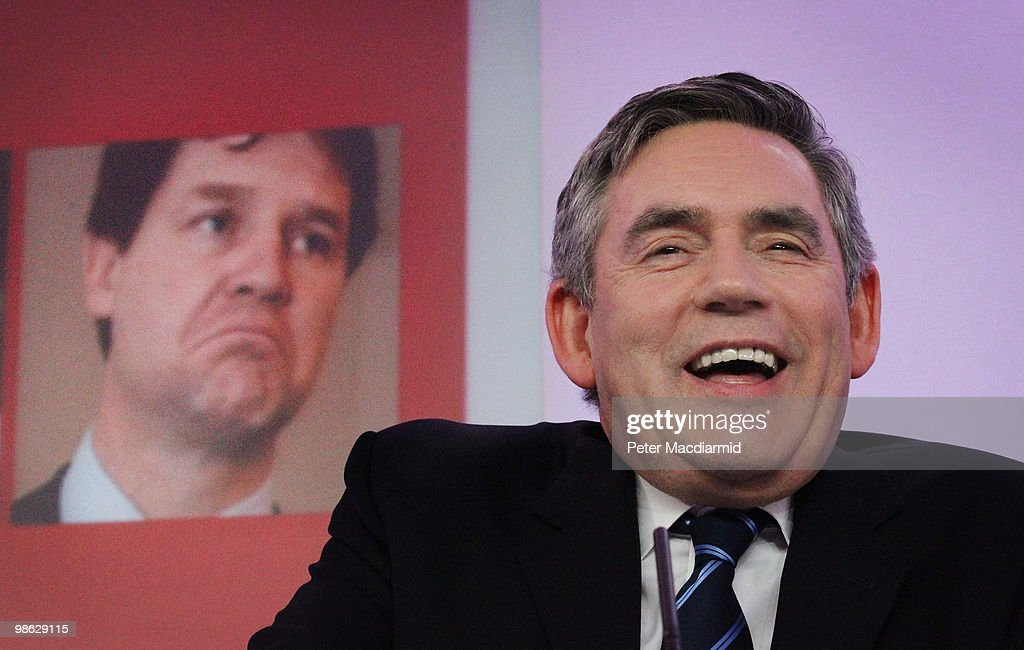 Prime Minister Gordon Brown sits in front of a photograph of Liberal Democrat leader Nick Clegg as he speaks to reporters, as the Labour Party continue their election campaign on April 23, 2010 in London, England. The General Election, to be held on May 6, 2010, is set to be one of the most closely fought political contests in recent times with all main party leaders embarking on a four week campaign to win the votes of the United Kingdom electorate.