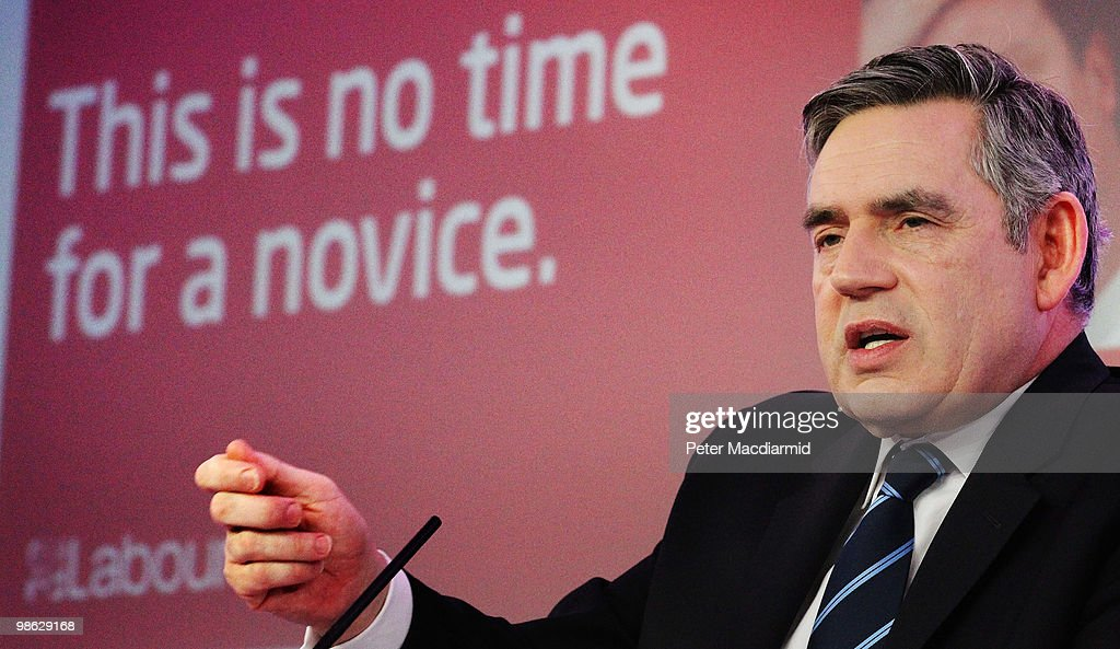 Prime Minister Gordon Brown sits infront of a poster attacking Conservative and Liberal Democrat leaders as speaks to reporters, as the Labour Party continue their election campaign on April 23, 2010 in London, England. The General Election, to be held on May 6, 2010, is set to be one of the most closely fought political contests in recent times with all main party leaders embarking on a four week campaign to win the votes of the United Kingdom electorate.