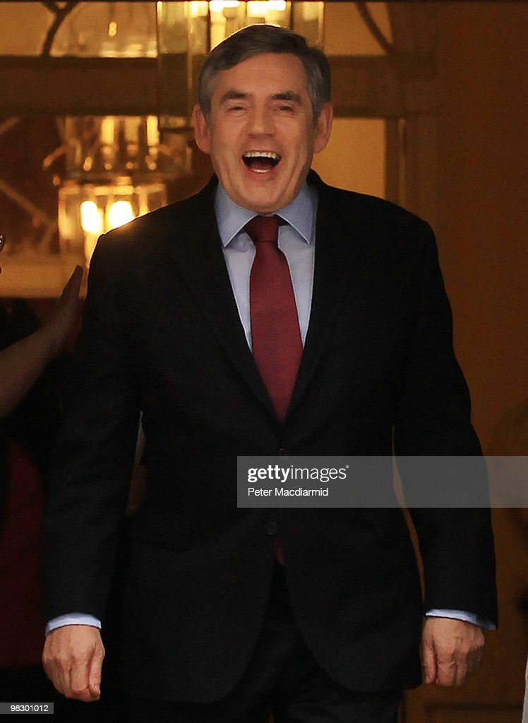 Prime Minister Gordon Brown smiles as he leaves Number 10 Downing Street for Parliament on April 7, 2010 in London, England. Mr Brown will face questions from Members of Parliament for the last time before the general election on May 6, 2010.