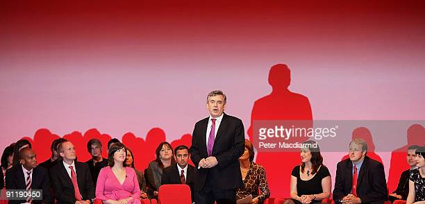 Prime Minister Gordon Brown stands on stage with future election candidates at the Labour Party Conference on September 29, 2009 in Brighton,...