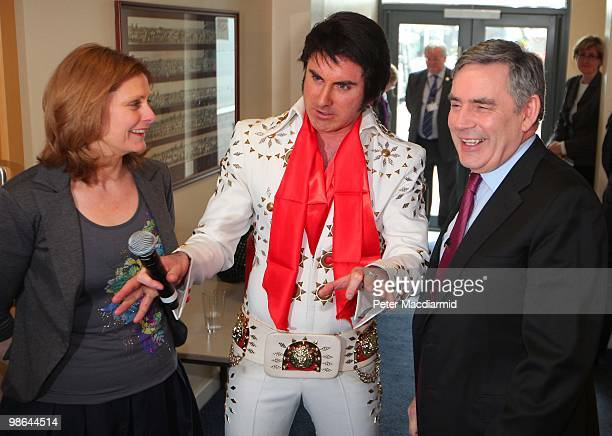 Prime Minister Gordon Brown stands with Elvis impersonator Mark Wright and Sarah Brown at Lodge Park Technology College on April 24, 2010 in Corby,...