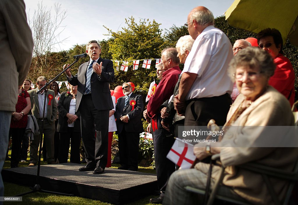 Prime Minister Gordon Brown talks to Labour party supporters in the back garden of a house on April 23, 2010 in Bedworth, England. The General Election, to be held on May 6, 2010, is set to be one of the most closely fought political contests in recent times with all main party leaders embarking on a four week campaign to win the votes of the United Kingdom electorate.
