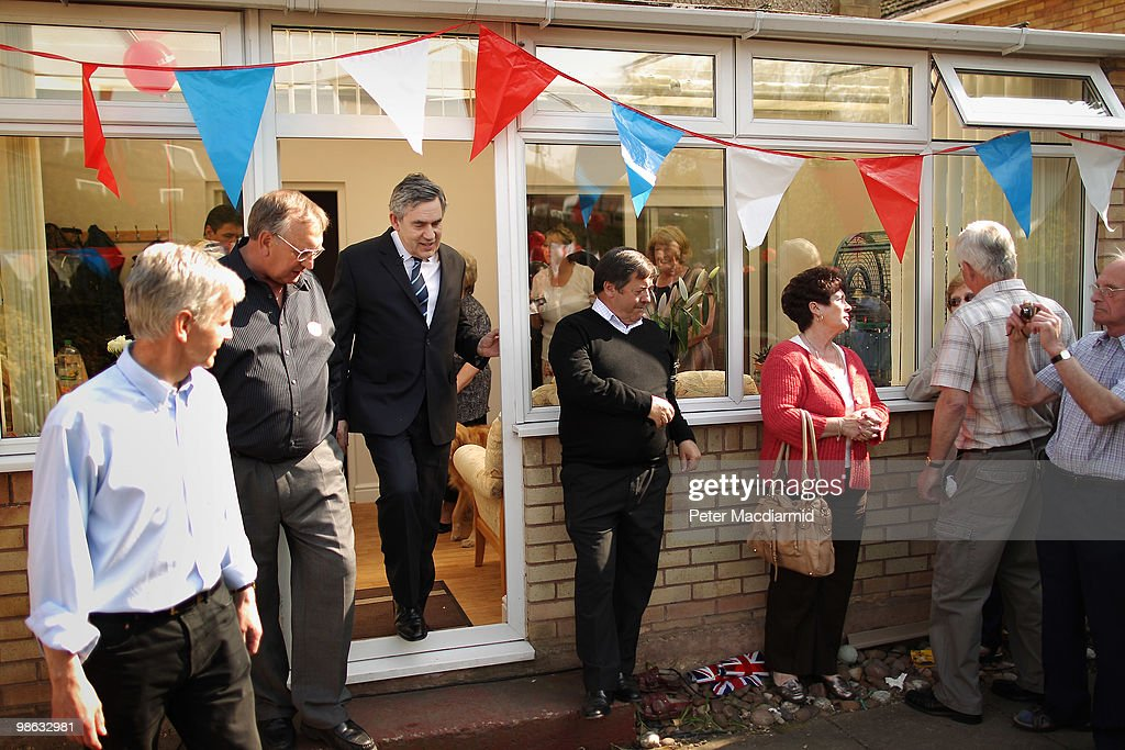 Prime Minister Gordon Brown walks through a conservatory to meet with local Labour party supporters at a house on April 23, 2010 in Bedworth, England. The General Election, to be held on May 6, 2010, is set to be one of the most closely fought political contests in recent times with all main party leaders embarking on a four week campaign to win the votes of the United Kingdom electorate.